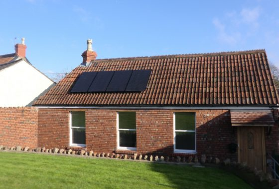 Black solar panels installed on a new build property