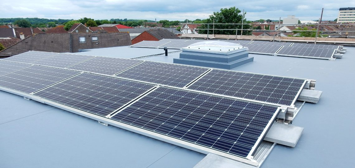 Black framed solar panels flat roof array